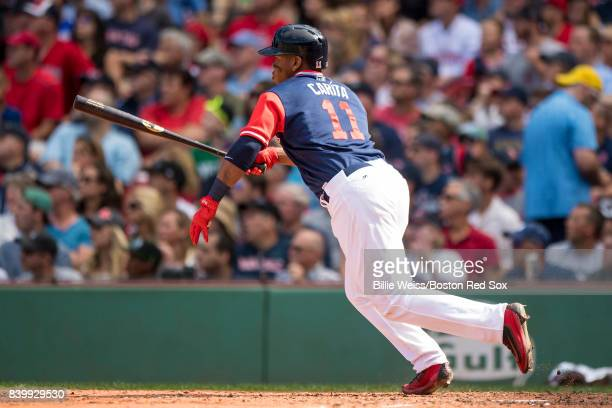 Rafael Devers of the Boston Red Sox hits an RBI double during the sixth inning of a game against the Baltimore Orioles on August 27 2017 at Fenway...