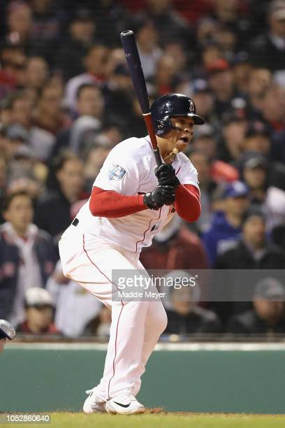 Rafael Devers of the Boston Red Sox hits an RBI single against the Los Angeles Dodgers in Game One of the 2018 World Series at Fenway Park on October...
