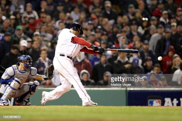 Rafael Devers of the Boston Red Sox hits an RBI single during the fifth inning against the Los Angeles Dodgers in Game One of the 2018 World Series...