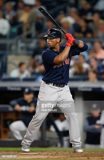 Rafael Devers of the Boston Red Sox in action against the New York Yankees during a game at Yankee Stadium on August 31 2017 in the Bronx borough of...