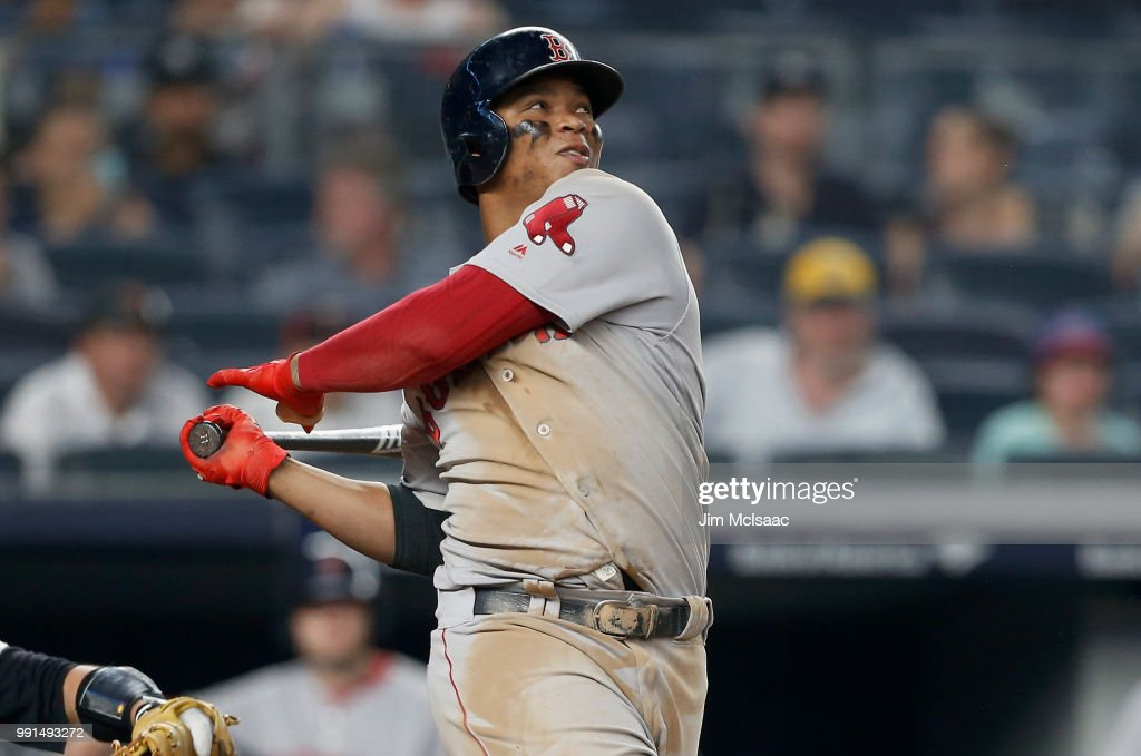 Rafael Devers #11 of the Boston Red Sox in action against the New York Yankees at Yankee Stadium on July 1, 2018 in the Bronx borough of New York City. The Yankees defeated the Red Sox 11-1.