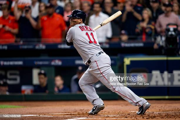 Rafael Devers of the Boston Red Sox its an RBI single during the first inning of game four of the American League Championship Series against the...