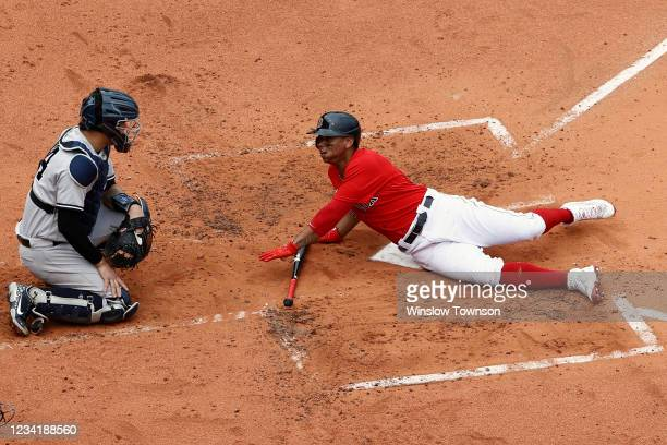 Rafael Devers of the Boston Red Sox looks back at Gary Sanchez of the New York Yankees after he was almost hit by a pitch during the second inning at...