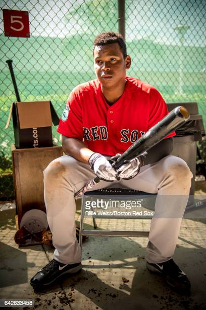 Rafael Devers of the Boston Red Sox looks on in the batting cage during a team workout on February 18 2017 at Fenway South in Fort Myers Florida