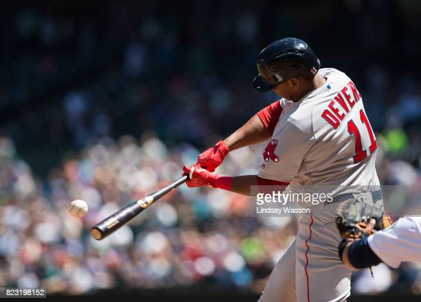 Rafael Devers of the Boston Red Sox makes contact for his first career hit a home run to center field off of Andrew Moore of the Seattle Mariners in...