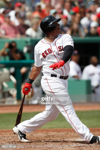 Rafael Devers of the Boston Red Sox makes some contact at the plate during the Spring Training game against the Baltimore Orioles at Jet Blue Park on...