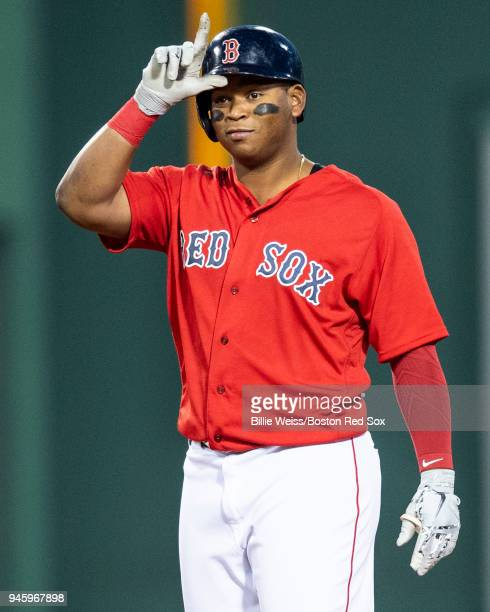 Rafael Devers of the Boston Red Sox reacts after hitting a double during the first inning of a game against the Baltimore Orioles on April 13 2018 at...