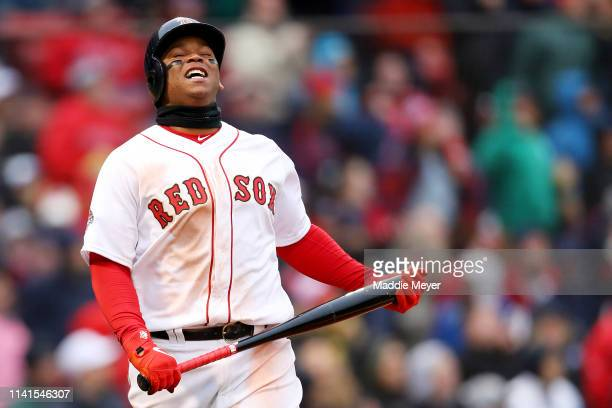 Rafael Devers of the Boston Red Sox reacts after hitting a foul ball during the eighth inning of the Red Sox home opening game against the Toronto...