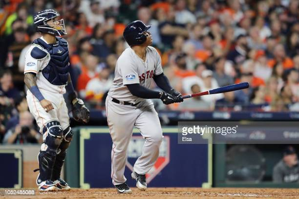 Rafael Devers of the Boston Red Sox reacts after hitting a threerun home run in the sixth inning against the Houston Astros during Game Five of the...