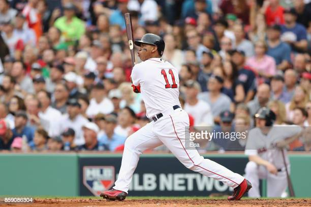 Rafael Devers of the Boston Red Sox reacts after hitting a tworun home run in the third inning against the Houston Astros during game three of the...