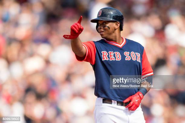 Rafael Devers of the Boston Red Sox reacts after hitting an RBI double during the sixth inning of a game against the Baltimore Orioles on August 27...