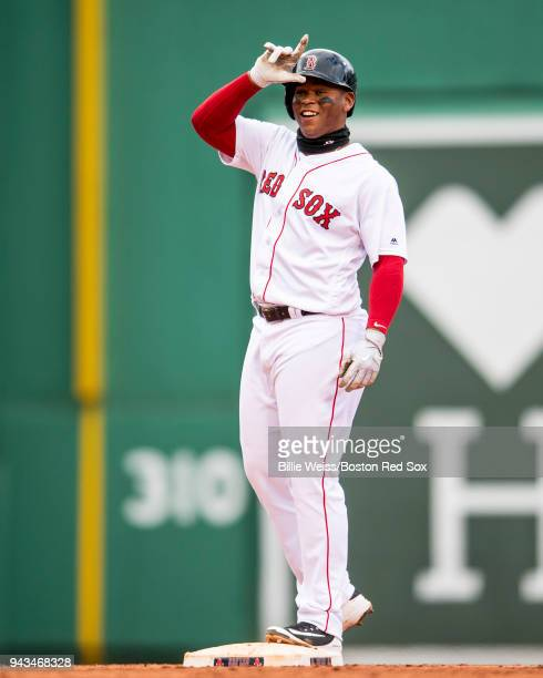 Rafael Devers of the Boston Red Sox reacts after hitting an RBI double during the eighth inning of a game against the Tampa Bay Rays on April 8 2018...