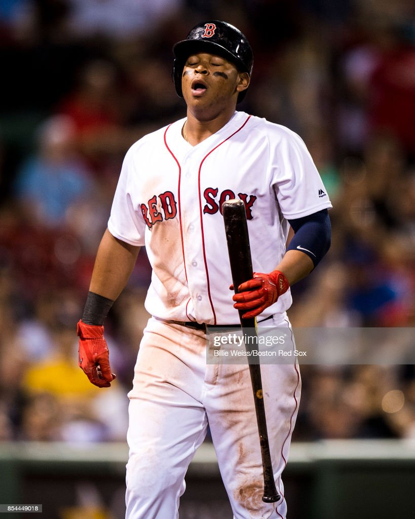 Rafael Devers #11 of the Boston Red Sox reacts after striking out during the ninth inning of a game against the Toronto Blue Jays on September 26, 2017 at Fenway Park in Boston, Massachusetts.