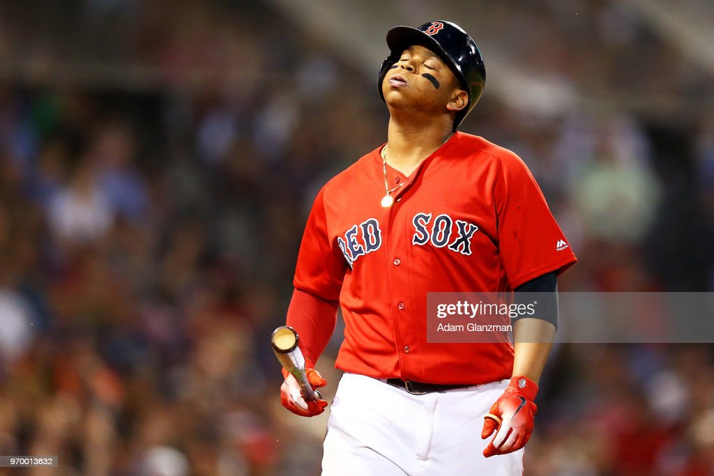 Rafael Devers #11 of the Boston Red Sox reacts after striking out in the seventh inning of a game against the Chicago White Sox at Fenway Park on June 08, 2018 in Boston, Massachusetts.