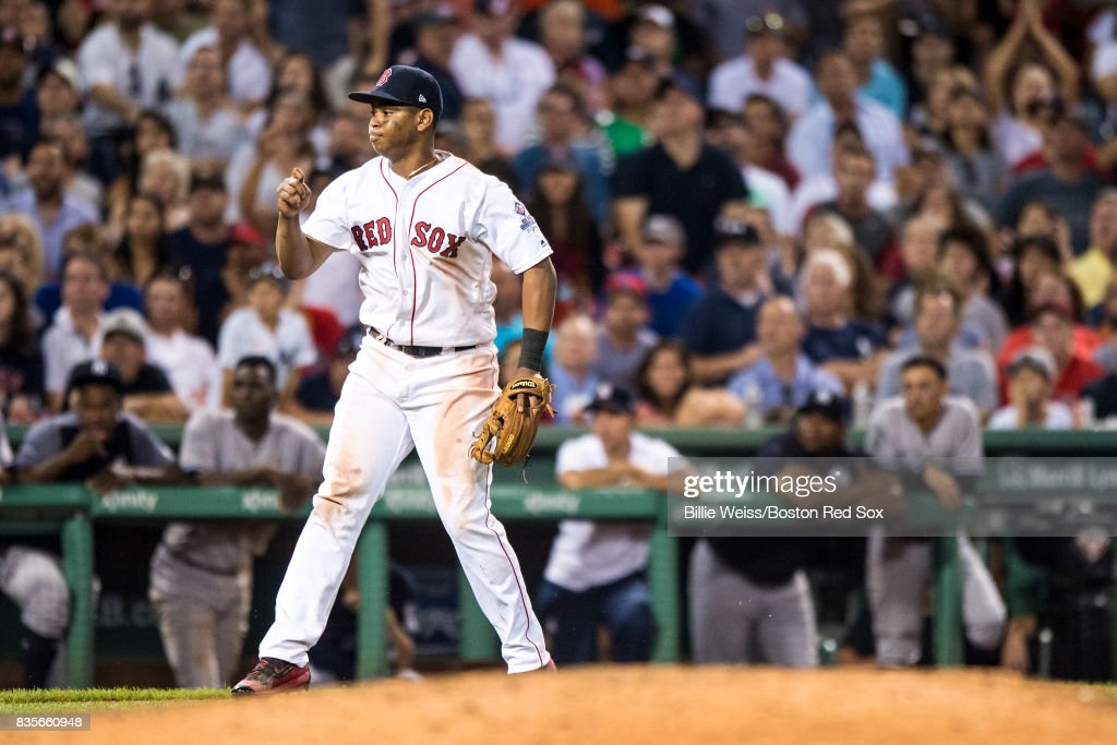 Rafael Devers #11 of the Boston Red Sox reacts after throwing out Jacoby Ellsbury #22 of the New York Yankees out at home plate during the eighth inning of a game on August 19, 2017 at Fenway Park in Boston, Massachusetts.