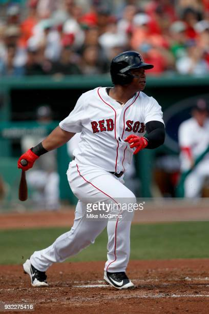 Rafael Devers of the Boston Red Sox reacts gets ready for the next pitch during the Spring Training game against the Baltimore Orioles at Jet Blue...