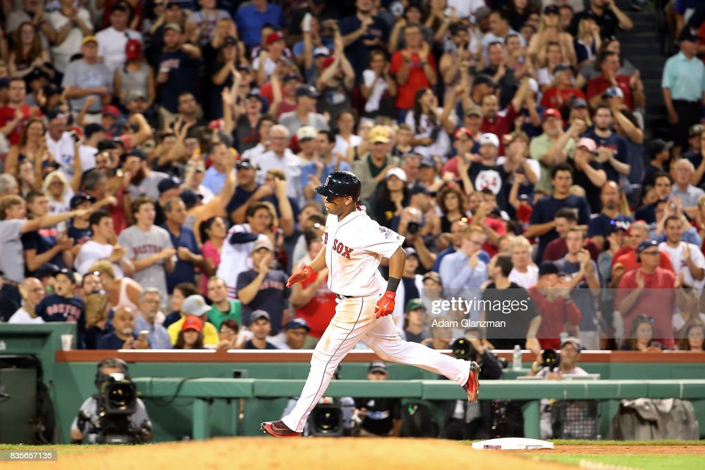Rafael Devers #11 of the Boston Red Sox rounds the bases after he hits a solo home run in the seventh inning of a game against the New York Yankees at Fenway Park on August 19, 2017 in Boston, Massachusetts.