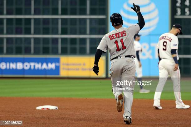 Rafael Devers of the Boston Red Sox rounds the bases after hitting a threerun home run in the sixth inning during Game 5 of the ALCS against the...