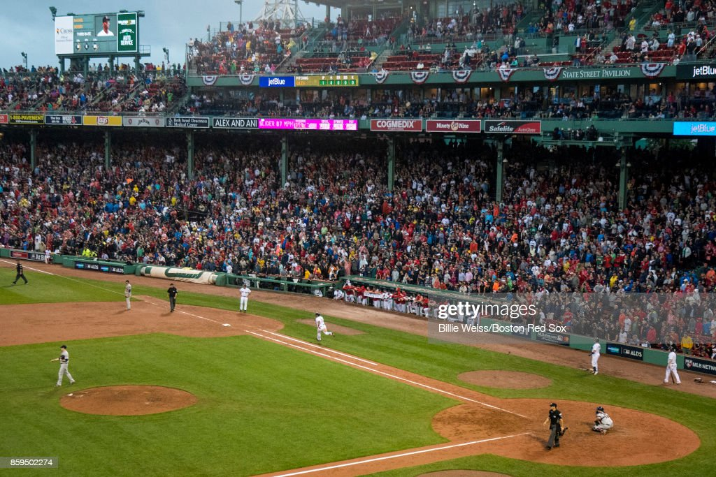Rafael Devers #11 of the Boston Red Sox rounds the bases as he hits an inside the park home run during the ninth inning of game four of the American League Division Series against the Houston Astros on October 9, 2017 at Fenway Park in Boston, Massachusetts.