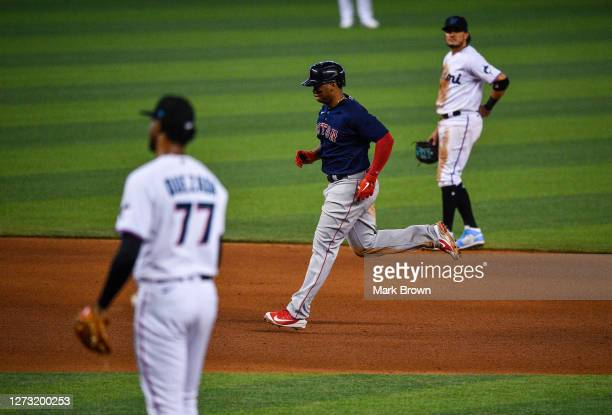 Rafael Devers of the Boston Red Sox runs the bases after hitting a three run home run in the seventh inning against the Miami Marlinsat Marlins Park...