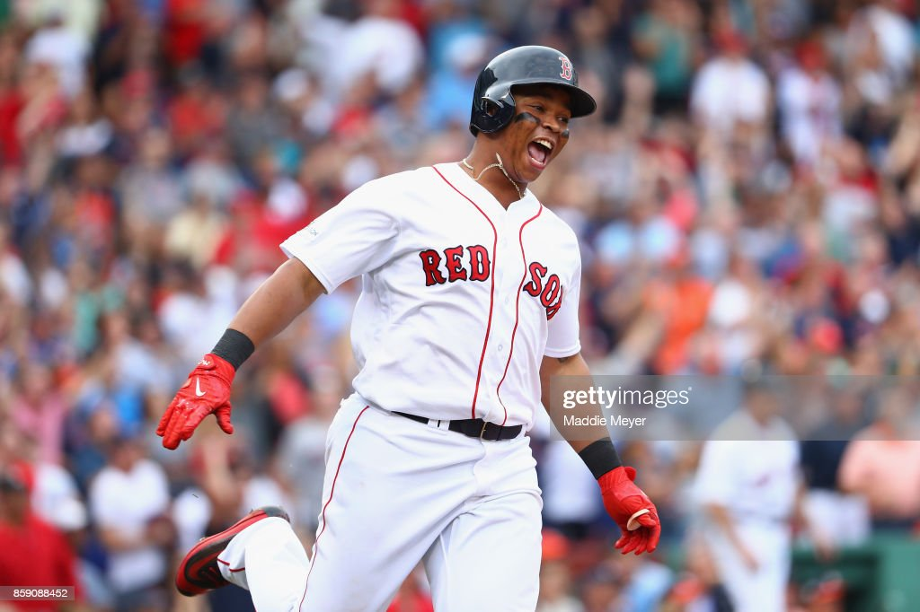 Rafael Devers #11 of the Boston Red Sox runs the bases after hitting a two-run home run in the third inning against the Houston Astros during game three of the American League Division Series at Fenway Park on October 8, 2017 in Boston, Massachusetts.