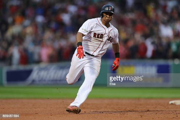 Rafael Devers of the Boston Red Sox runs the bases after hitting an inside the park home run in the ninth inning against the Houston Astros during...