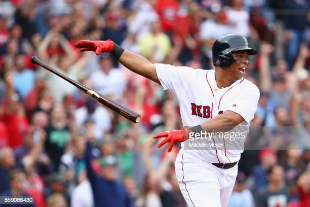 Rafael Devers of the Boston Red Sox throws his bat after hitting a tworun home run in the third inning against the Houston Astros during game three...