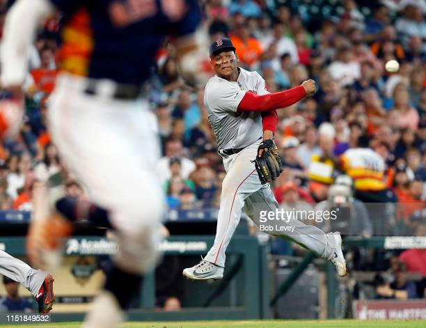 Rafael Devers of the Boston Red Sox throws out Carlos Correa of the Houston Astros in the third inning on a soft ground ball at Minute Maid Park on...