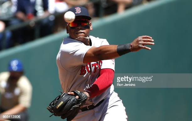 Rafael Devers of the Boston Red Sox throws to first base after fielding a ball off the bat of Ronald Guzman of the Texas Rangers during the second...