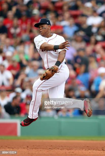 Rafael Devers of the Boston Red Sox throws to first base during Game 3 of the American League Division Series against the Houston Astros at Fenway...