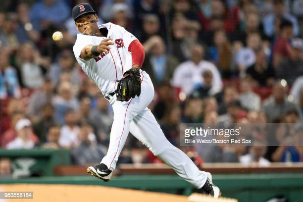 Rafael Devers of the Boston Red Sox throws to first base during the second inning of a game against the Kansas City Royals on May 1 2018 at Fenway...