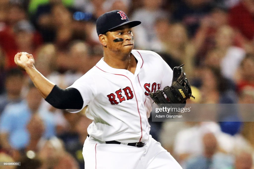 Rafael Devers #11 of the Boston Red Sox throws to second base in the fifth inning of a game against the Texas Rangers at Fenway Park on July 9, 2018 in Boston, Massachusetts.