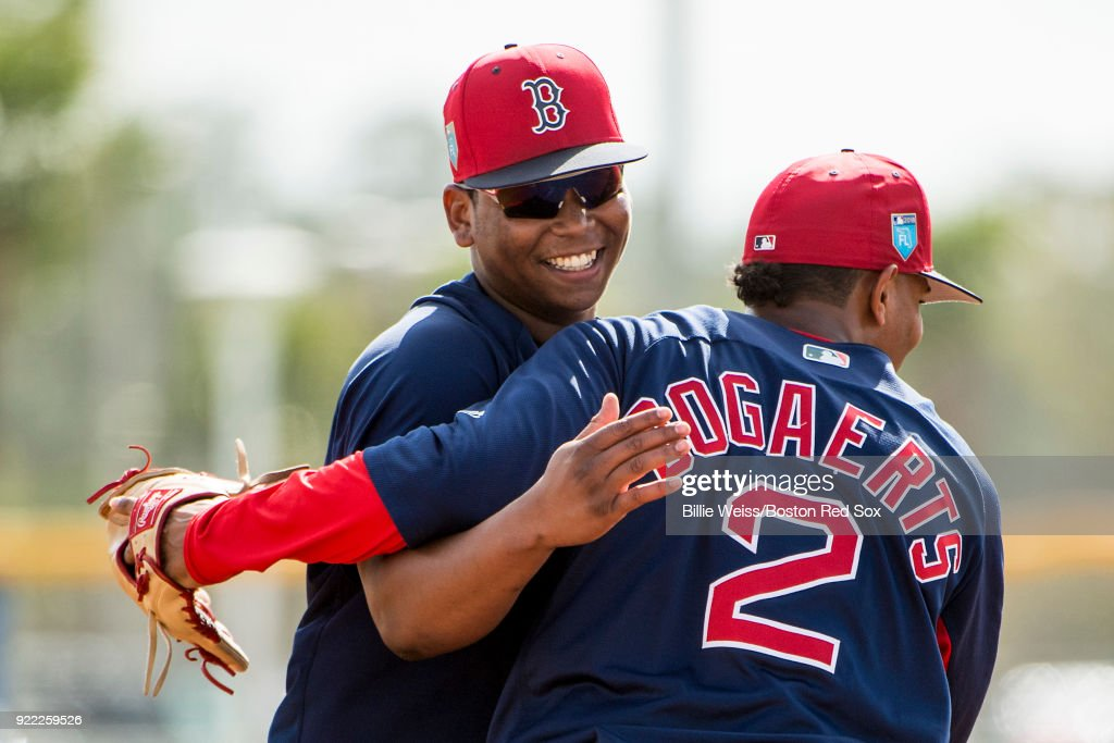 Rafael Devers #11 reacts with Xander Bogaerts #2 of the Boston Red Sox during a team workout on February 21, 2018 at jetBlue Park at Fenway South in Fort Myers, Florida .