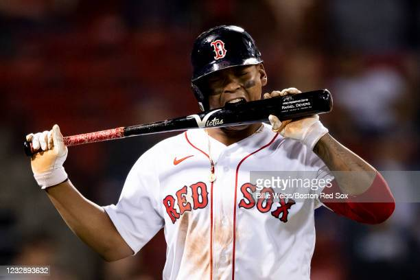 Rafael Devers the Boston Red Sox reacts after flying out during the eighth inning of a game against the Los Angeles Angels on May 14, 2021 at Fenway...