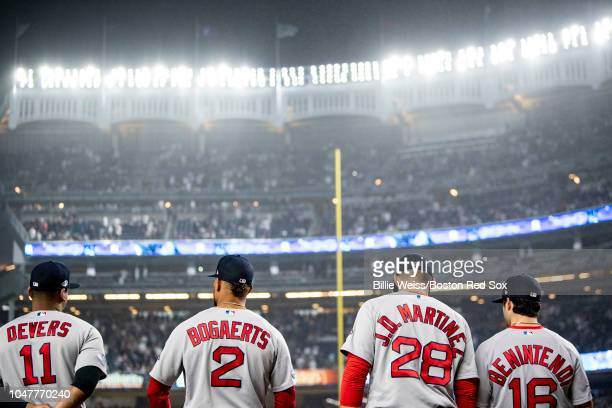 Rafael Devers Xander Bogaerts JD Martinez and Andrew Benintendi of the Boston Red Sox look on before game three of the American League Division...