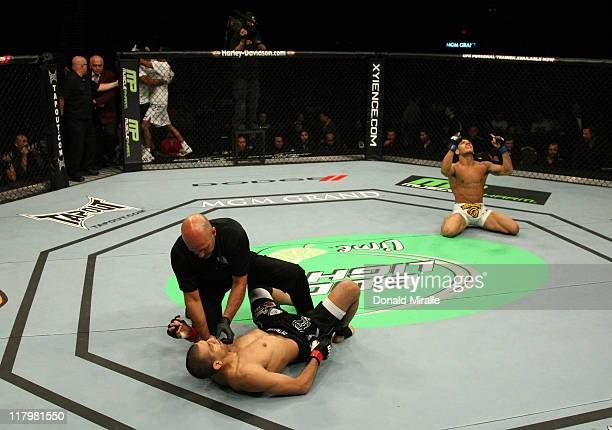 Rafael Dos Anjos celebrates after knocking out George Sotiropoulos in a lightweight bout at UFC 132 at MGM Grand Garden Arena on July 2 2011 in Las...