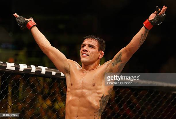 Rafael dos Anjos celebrates his victory by unanimous decision over Nate Diaz in their heavyweight bout during the UFC Fight Night event at the at...