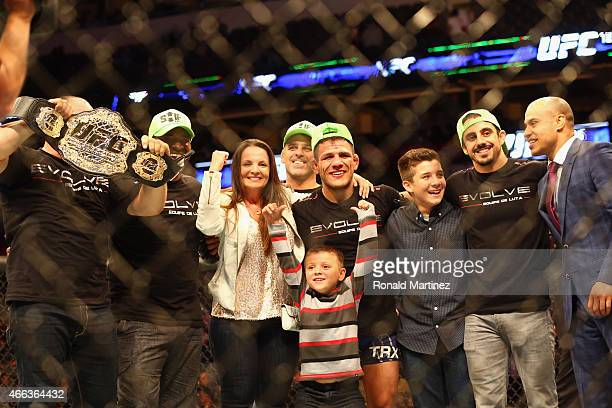 Rafael dos Anjos celebrates his win against Anthony Pettis in the Lightweight Title bout during the UFC 185 event at American Airlines Center on...