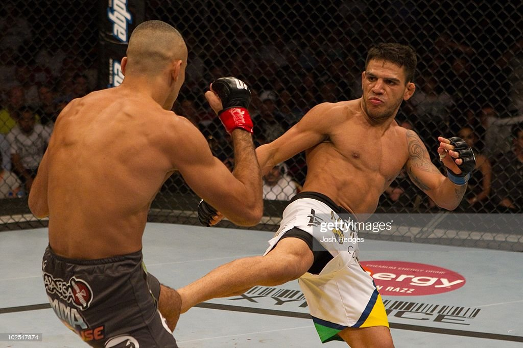Rafael dos Anjos (white shorts) def. Terry Etim (grey shorts) - Submission (arm bar) - 4:30 round 2 during UFC 112 at Yas Island on April 10, 2010 in Abu Dhabi, United Arab Emirates.