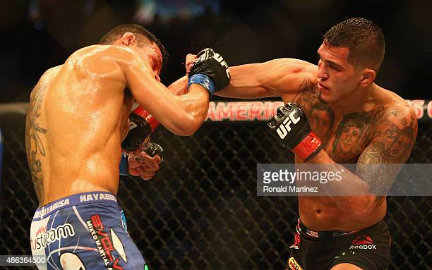 Rafael dos Anjos fights with Anthony Pettis in the Lightweight Title bout during the UFC 185 event at American Airlines Center on March 14 2015 in...