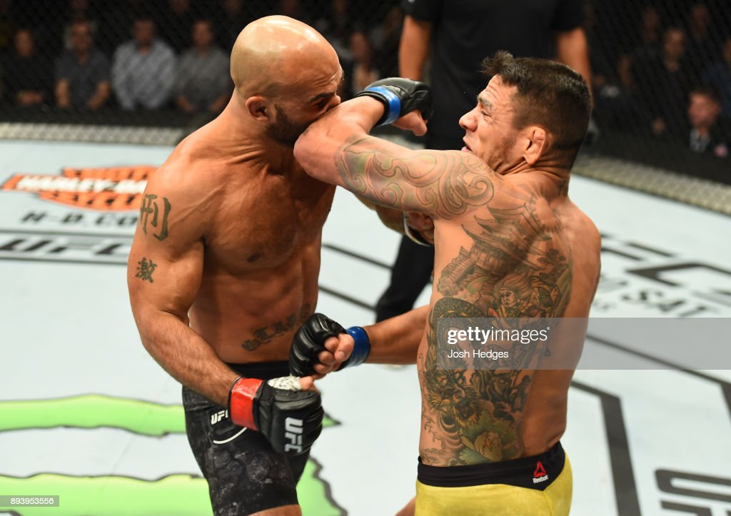 Rafael Dos Anjos of Brazil elbows Robbie Lawler in their welterweight bout during the UFC Fight Night event at Bell MTS Place on December 16, 2017 in Winnipeg, Manitoba, Canada.