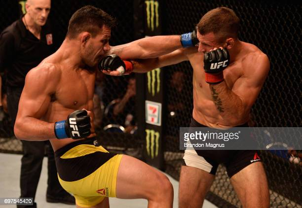 Rafael Dos Anjos of Brazil exchanges punches with Tarec Saffiedine of Belgium in their welterweight bout during the UFC Fight Night event at the...