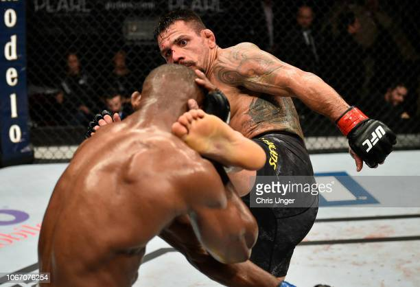 Rafael Dos Anjos of Brazil kicks Kamaru Usman of Nigeria during The Ultimate Fighter Finale event inside The Pearl concert theater at Palms Casino...