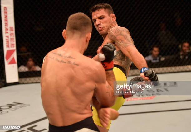 Rafael Dos Anjos of Brazil kicks Tarec Saffiedine of Belgium in their welterweight bout during the UFC Fight Night event at the Singapore Indoor...