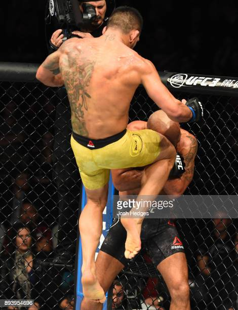 Rafael Dos Anjos of Brazil knees Robbie Lawler in their welterweight bout during the UFC Fight Night event at Bell MTS Place on December 16 2017 in...