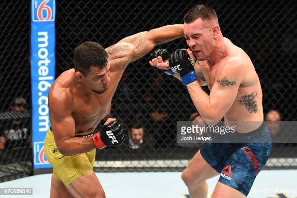 Rafael Dos Anjos of Brazil punches Colby Covington in their interim welterweight title fight during the UFC 225 event at the United Center on June 9...