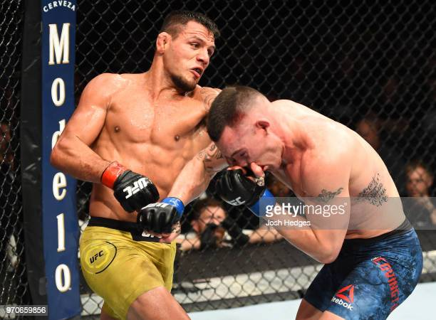 Rafael Dos Anjos of Brazil punches Colby Covington in their interim welterweight title fight during the UFC 225 event at the United Center on June 9,...