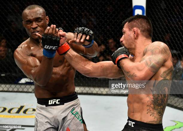 Rafael Dos Anjos of Brazil punches Kamaru Usman of Nigeria during The Ultimate Fighter Finale event inside The Pearl concert theater at Palms Casino...