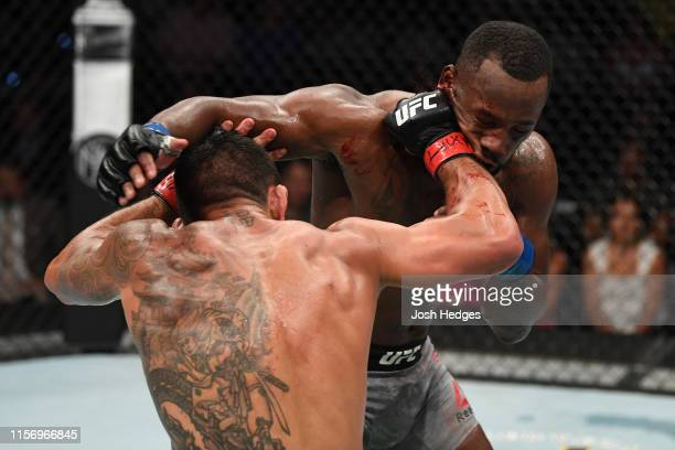 Rafael Dos Anjos of Brazil punches Leon Edwards of Jamaica in their welterweight bout during the UFC Fight Night event at AT&T Center on July 20,...