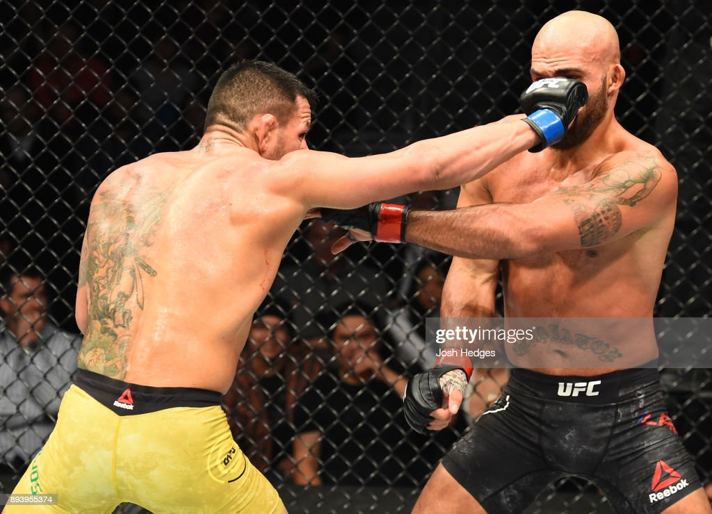 Rafael Dos Anjos of Brazil punches Robbie Lawler in their welterweight bout during the UFC Fight Night event at Bell MTS Place on December 16, 2017 in Winnipeg, Manitoba, Canada.